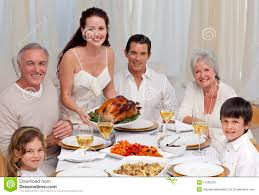 family at thanksgiving dinner family eating turkey in a dinner stock photo image 11569070