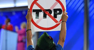 Putting America First       Will Trump Really Abandon TTP  A delegate hoists and anti TPP sign on Day   of the Democratic National Convention