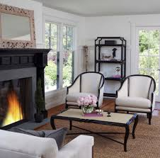 black painted fireplace with black fireplace mantel living room