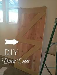 Sliding Barn Doors A Practical Solution For Large Or by Installing A Sliding Barn Door In The Home Barn Doors Barn And
