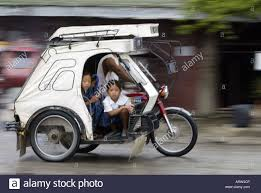 philippine tricycle design children ride a tricycle taxi to in mansalay oriental