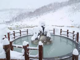 open air japanese bath pool on snowy day in winter
