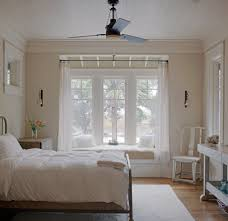 curtain rods for bay windows vogue charleston beach style bedroom