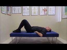 supine pelvic tilt exercise for spondylolisthesis youtube