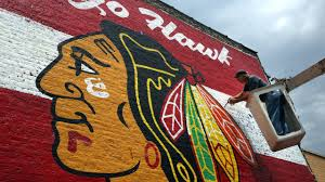giant blackhawks mural painted on brick wall youtube