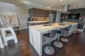 peninsula island kitchen fm distributing neolith classtone estatuario and beton modern