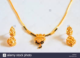 gold earrings for marriage concept gold black necklace mangalsutra hindu symbol