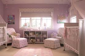 pink and purple nursery for twin girls features purple walls