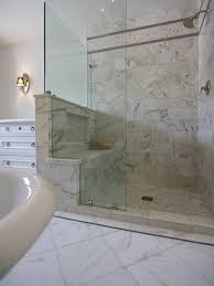 Bathroom Bench Ideas by Calacatta Marble Enrobes This Glass Enclosed Shower To