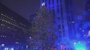 rockefeller center turns on its christmas tree lights