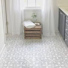 this chalk paint and stenciling on a linoleum bathroom