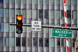 red light camera ticket settlement red light camera grace period goes from 0 1 to 0 3 seconds chicago