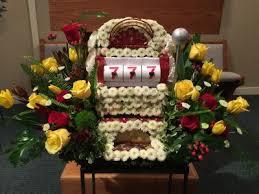 funeral floral arrangements slot machine themed funeral flowers in webster tx la mariposa
