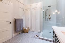 modern elegant bathroom with washer and dryer that has grey fridge
