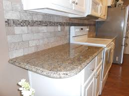 interior new caledonia granite with tile backsplash and arch
