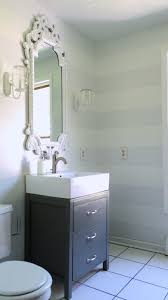 remodelaholic cute striped wall update for half bath