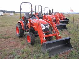 ck2610 compact tractor with loader qa bucket and rear blade