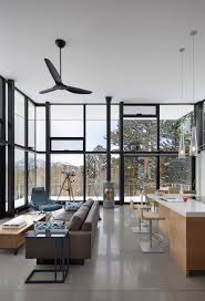 living and eating area features double height glass walls to