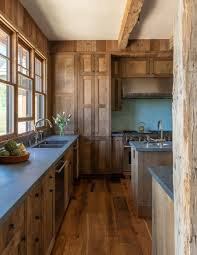 stained wood kitchen cabinets 2019 home trend for 2020 into the wood cowboys and indians