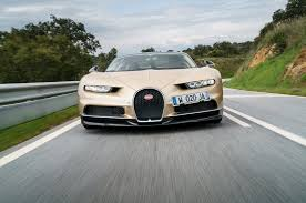 bugatti chiron gold bugatti bentley and lamborghini pivot to evs and hybrids
