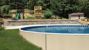 radiant 24 u0027 semi inground round built into a hill radiant pools