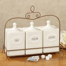 placing white kitchen canisters from ceramic to prettify your