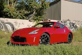nissan 370z z 0 to 60 time 2015 hyundai genesis coupe vs 2016 nissan 370z autoguide com news