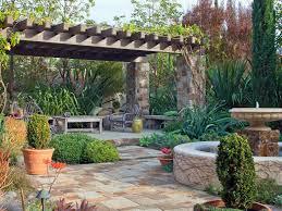 Flagstone Patio With Pergola Our Favorite Designer Outdoor Rooms Hgtv