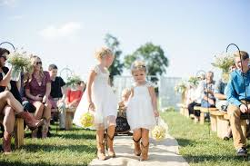 flower girls in white dresses with cowboy boots