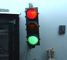 stop and go light why does red mean stop and green go