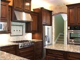 kitchen cabinets and backsplash awesome dark cherry kitchen cabinets with granite countertops