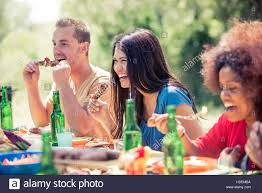 multicultural group of friends grilling and having party in the