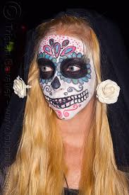Day Of The Dead White Sugar Skull Makeup And White Flowers In Blond Hair