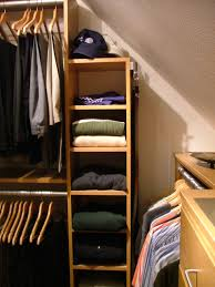 slanted ceiling closet design ideas pictures remodel and here s a closet with a sloped ceiling remodel bob ideas