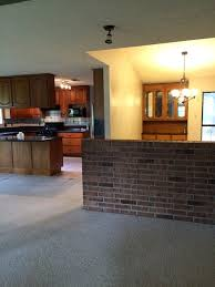 Remove Brick Fireplace by Should We Remove This Brick Half Wall