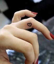 50 beautiful girly finger tattoos