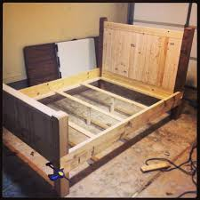 Diy Full Size Platform Bed With Storage Plans by Diy Full Size Bed Frame Almost Finished Made With 2x4s 2x8s And