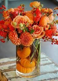 thanksgiving centerpiece with orange flowers pumpkins pictures