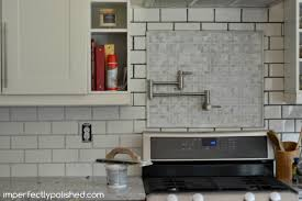 Grouting Kitchen Backsplash Re Grouting Tile White Subway And Marble Tile Backsplash