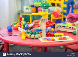toys on a table in the children u0027s playroom stock photo royalty