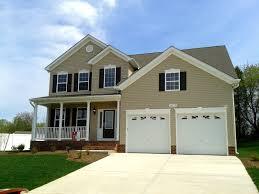 home exterior design catalog tan siding with navy shutters and white trim love exterior curb