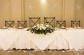 main table at a wedding reception with beautiful flowers stock