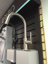 no touch kitchen faucet bathroom omicron granite countertop with kraus sinks and delta
