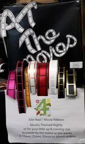 film movie reel gift wrapping printed ribbon spelling gift wrap