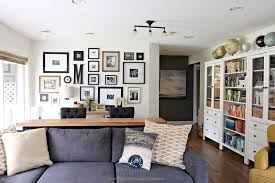family room with photo gallery wall gray sectional ikea hemnes