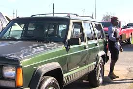 jeep cherokee christmas ornament ups staff comes together to surprise co worker with a car