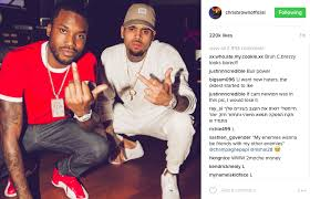 are chris brown and meek mill giving the middle finger