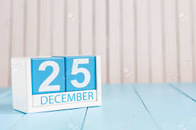 december 25th day 25 of month calendar on wooden