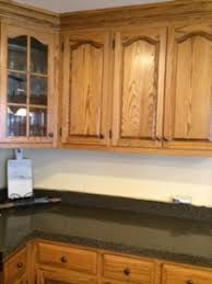 how to whitewash stained cabinets whitewashing honey oak kitchen cabinets the process begins