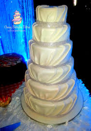 6 tier pearl white pleated fondant wedding cake with bling banding